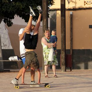 Practicing a Handstand on a skateboard in El Cotillo